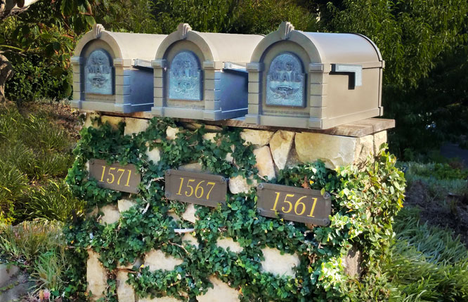 Three quaint ivy covered mailboxes